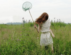 Measuring Happiness As Elusive As Catching Butterflies - Girl With Butterfly Catcher In Hand