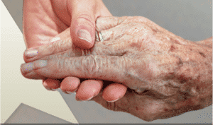 Young hand holding aging hand