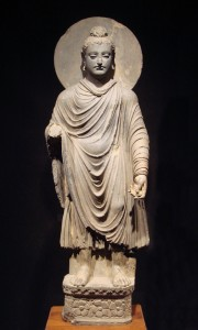 An early Gandharan statue of Buddha, 1st-2nd century CE, in the Tokyo National Museum.