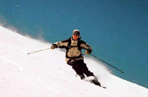 a man skiing down a slope