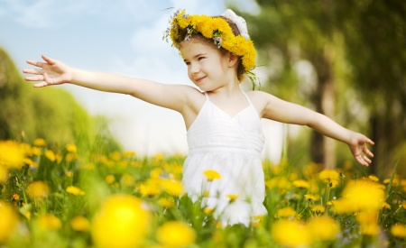 girl with flower crown in field of flowers