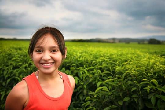 Happy Girl Smiling - Happiness Habits