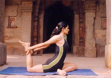 a woman stretching on a yoga mat
